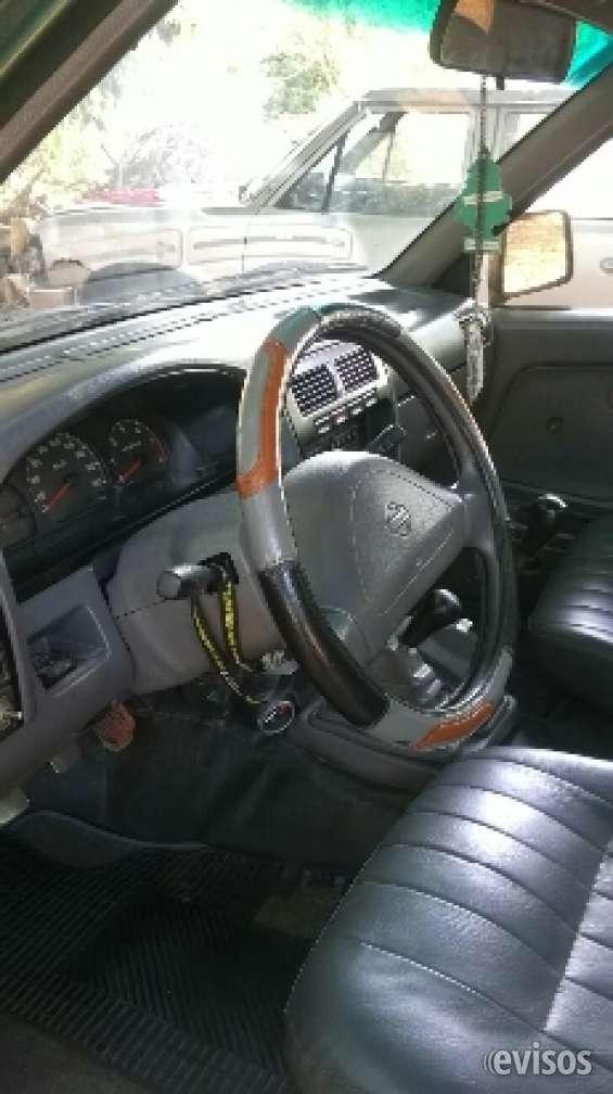 Vendo camioneta nissan ano99 modelo ax 4x4.original con cd vrde y avilitacion a mano