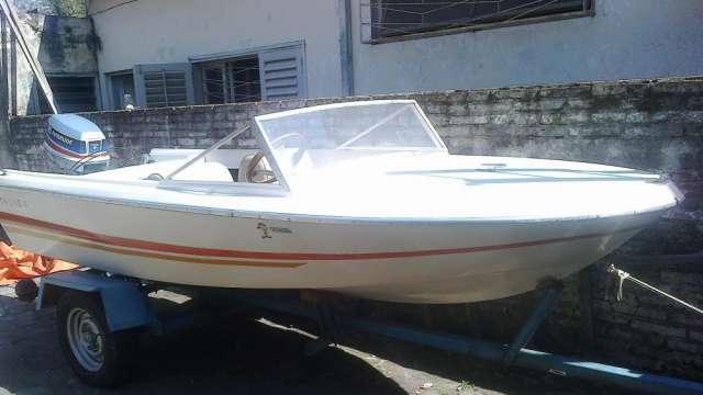Vendo embarcacion con motor evinrude de 35 hp