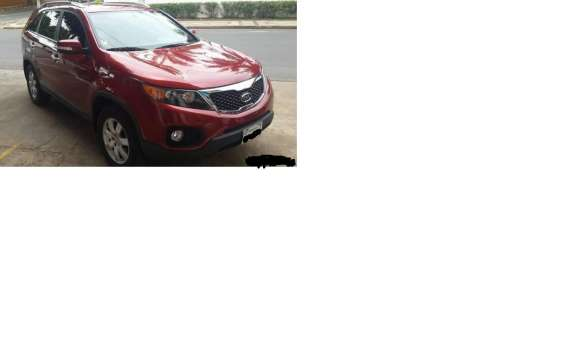 Vendo kia sorento, 2012 , color bordo, naftero, caja mecanica, impecable estado!!!