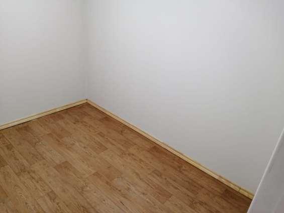 Colocación de pisos vinilicos simil madera y alfombras